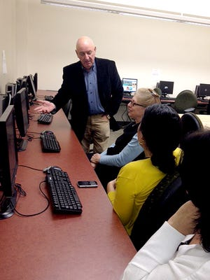 Dr. Kevin Nash, MBA/MPA Program Director, instructs students at LIU Hudson's Westchester Graduate Campus.
