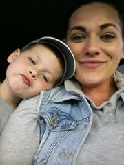 Leah DiGiovannantonio, 28, poses with her son Oscar, 5. Leah is two years clean, but struggled with an opiate addiction. Oscar was born with neonatal abstinence syndrome, essentially addicted to the methadone she was taking to withdraw from the drugs. Now the pair are happy, healthy and living in Newark.