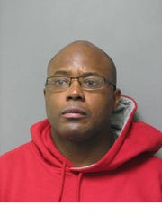 David Harris, 43, attempted to hide in the bathroom of the Rehobeth Beach home, police said.