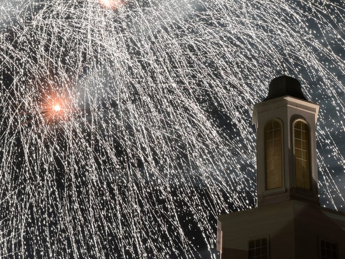 Fireworks explode over the campus at  Arkansas State University Mountain Home during the Red, White & Blue Festival.
