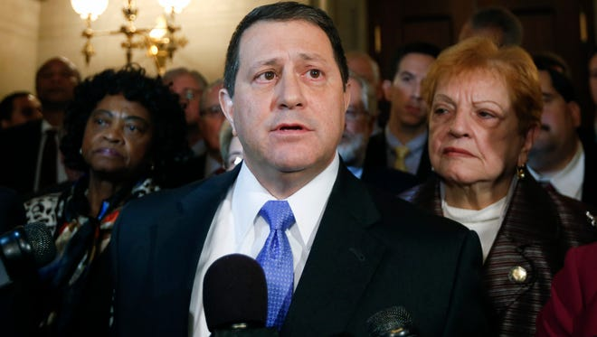 Assembly Majority Leader Joseph Morelle, D-Rochester, with Democratic members of the Assembly behind him, talks to reporters at the Capitol about the arrest of Assembly Speaker Sheldon Silver.