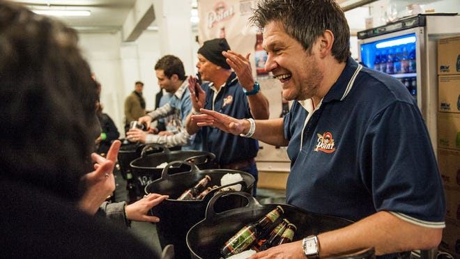 Sales staff for the Stevens Point Brewery sample beer in the United Kingdom. The brewery has expanded production from 60,000 barrels to 150,000 barrels since 2008.