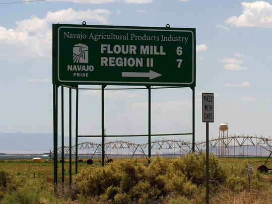 A sign for Navajo Agricultural Products Industry's flour mill is pictured Friday along N.M. Highway 371 south of Farmington.