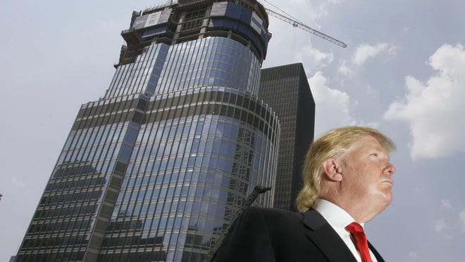 In this May 24, 2007, file photo, Donald Trump is profiled against his then-under construction 92-story Trump International Hotel & Tower in Chicago.