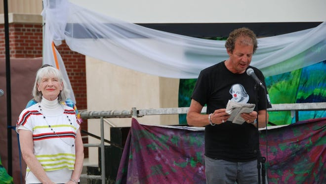 2015 Sonnet Contest winner Beth Blair looks on as actor Phil Croton reads her sonnet.
