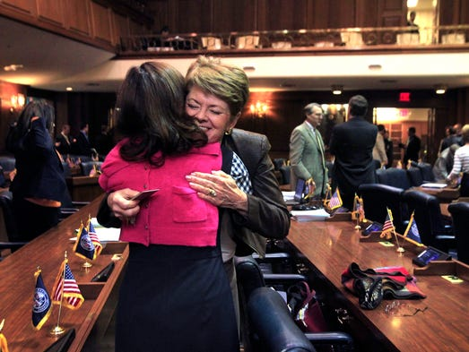 Rep. Gail Riecken, D-Evansville, gives a hug after the Indiana House of Representatives finished their work for the session about 10:30 p.m. on Thursday, March 13, 2014.