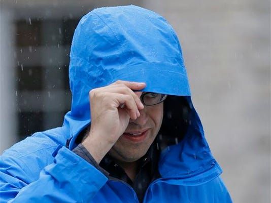 In this July 7, 2015, file photo, Subway restaurant spokesman Jared Fogle walks to a waiting car as he leaves his home in Zionsville, Ind. Fox 59 television station reported Tuesday, Aug. 18 that the Subway pitchman is expected to plead guilty to child-pornography charges, citing sources it did not identify. (AP Photo/Michael Conroy, File)