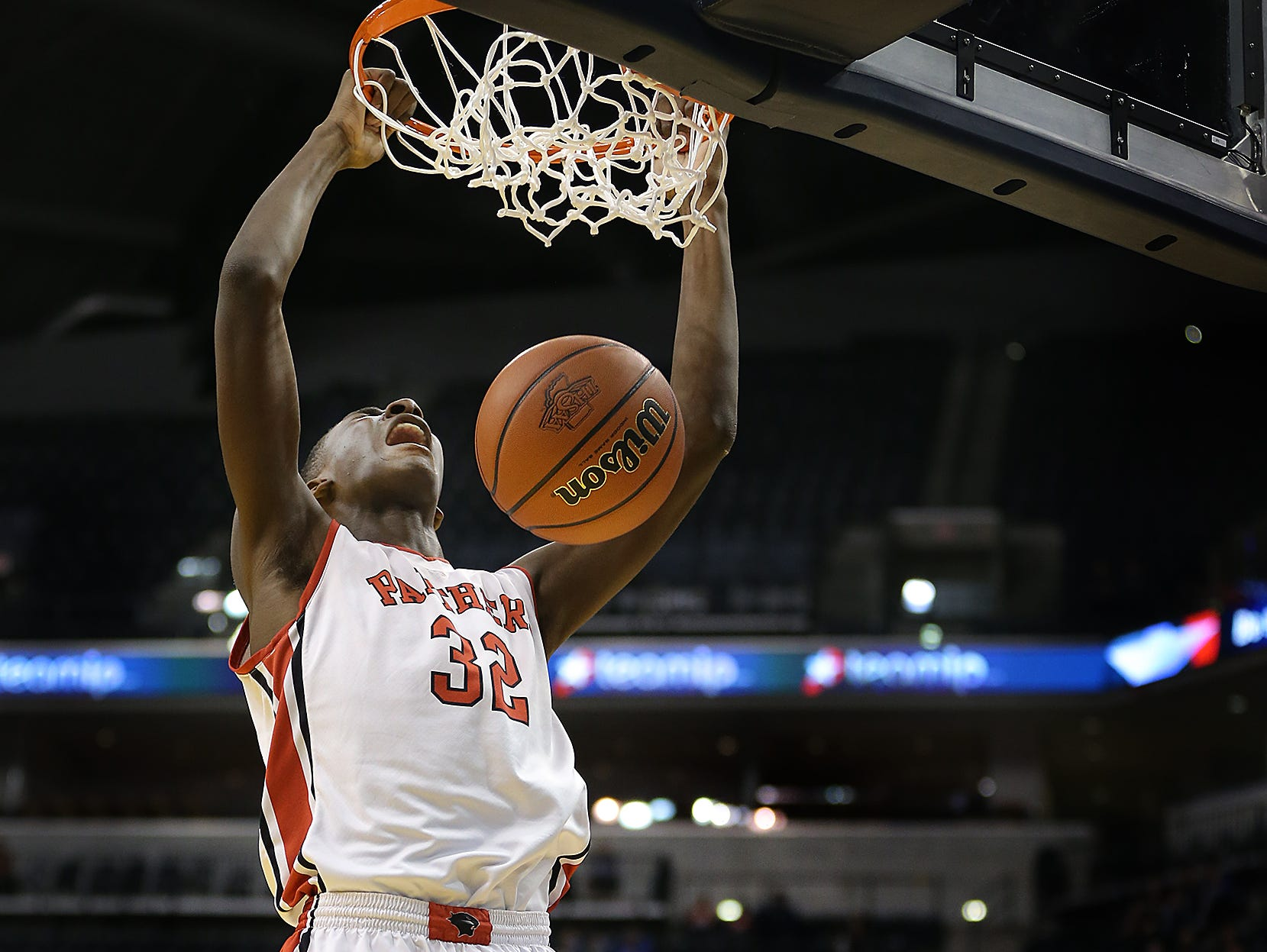Park Tudor's Jaren Jackson Jr., dunks on Frankton's Maurice Knight,right, during their ISHAA 2A State Championship game. The Park Tudor Panther defeated the Frankton Eagles 73-46 to win the IHSAA 2A Boys Basketball State Final Saturday, March 28, 2015, afternoon at Bankers Life Fieldhouse.
