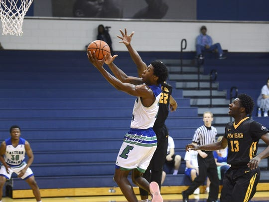 Eastern Florida guard Kareem Brewton scores during a game against Palm Beach State.