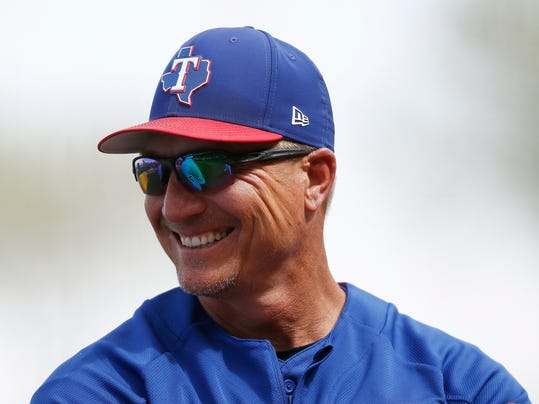 FILE - In this March 8, 2018, file photo, Texas Rangers manager Jeff Banister smiles as he talks with the umpires during the second inning of a spring training baseball game against the Chicago White Sox in Surprise, Ariz. The Rangers opening the season on March 29, when they host the Houston Astros. (AP Photo/Ross D. Franklin, File)