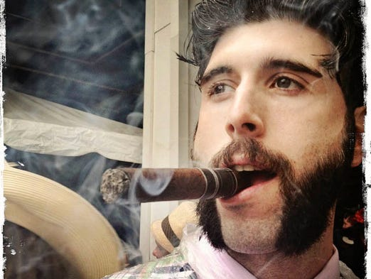 Patrick Cawley of Massachusetts enjoying a cigar on Derby Day. May 4th, 2013