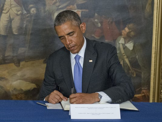 Obama Signs Condolence Book at the Embassy of France
