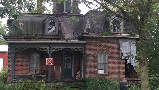 This house at 285 North Buena Vista St. is one of 225 properties on the city's latest list of property maintenance code violations. Fines and fees on the property, which may be demolished, total $4,635.