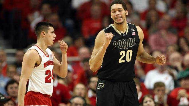 Purdue center A.J. Hammons (20) reacts after drawing a foul against Wisconsin during the first half of Saturday's Big Ten tournament semifinal at United Center.