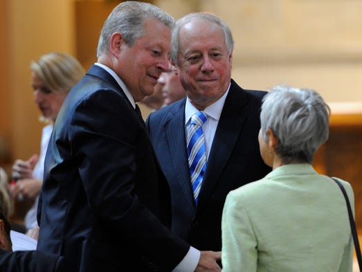 Vice President Albert Gore, Jr., speaks with Andre Conte and Governor Phil Bredesen speak with Katie Seigenthaler at the Cathedral of the Incarnation Monday July 14, 2014, in Nashville, Tenn.
