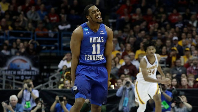 Middle Tennessee State's Edward Simpson reacts after making a three-point basket against Minnesota in a first-round NCAA Tournament game