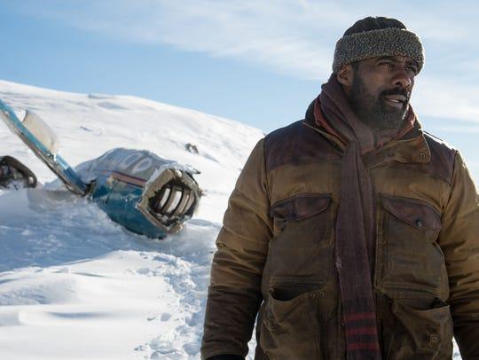 """Ben (Idris Elba) survives a plane crash in """"The Mountain"""