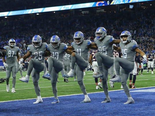 The Detroit Lions form a dance line after a touchdown