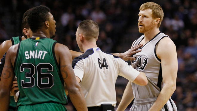 San Antonio Spurs forward Matt Bonner exchanges words with Boston Celtics point guard Marcus Smart after Smart punched Bonner in the crotch during Friday's game in San Antonio.