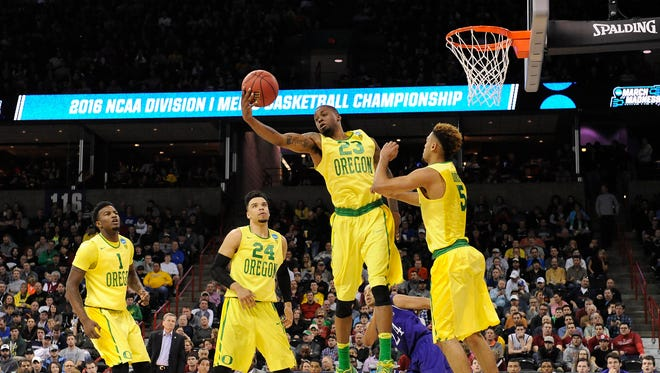 March 18, 2016; Spokane , WA, USA; Oregon Ducks forward Elgin Cook (23) grabs a rebound against Holy Cross Crusaders during the second half in the first round of the 2016 NCAA Tournament at Spokane Veterans Memorial Arena. Mandatory Credit: Kyle Terada-USA TODAY Sports
