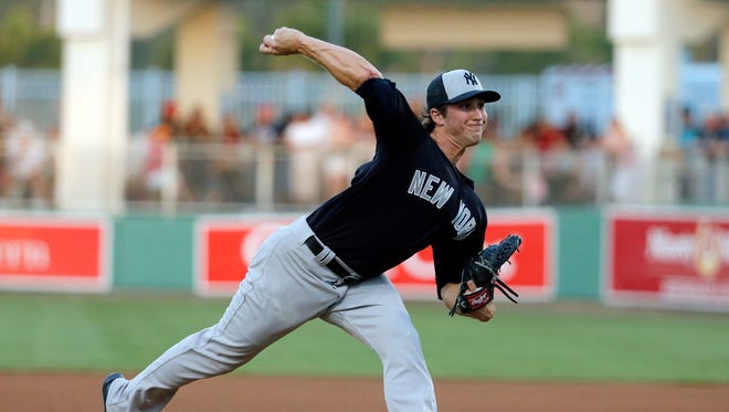 New York Yankees relief pitcher Bryan Mitchell (55) works against the Boston Red Sox in the fifth inning of a spring training baseball game, Tuesday, March 15, 2016, in Fort Myers, Fla.