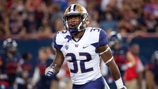 Washington Huskies defensive back Budda Baker (32) was drafted by the Arizona Cardinals during the second round. Baker celebrates after a Arizona Wildcats fumble during the fourth quarter at Arizona Stadium. Washington won 35-28 in overtime, Sept. 24, 2016.