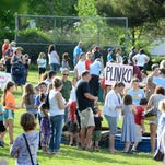 McKinley Elementary School hosts a neighborhood celebration for its 100th birthday on Friday, May 29, 2015. The event featured a play performed by students, carnival games, vintage cars, food and more.