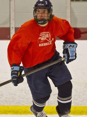 Hockey season preview featuring Howell High School. Kyle Hallbauer goes through drills.  Farmingdale, NJ Thursday, November 20, 2014  Doug Hood/Staff Photographer