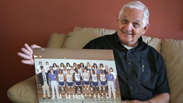 Gayle Towles shows a photo, Monday, April 18, 2016, of the Ben Davis High School boys basketball team he took to semistate during the 1987-88 season.