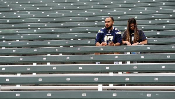 Los Angeles Chargers fans sit in the stands before the game against the Miami Dolphins at StubHub Center.