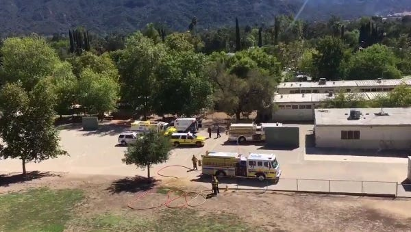 A helicopter and crews responded to Topa Topa Elementary School on Monday when a tree branch fell and injured at least three people.