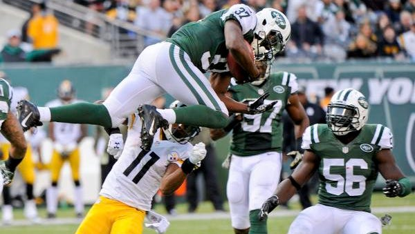 Jets free safety Jaiquawn Jarrett leaps over intended receiver Markus Wheaton (11) to intercept a pass as teammate Demario Davis (56) watches in the third quarter Sunday. Jarrett had two interceptions, a fumble recovery and a sack as the Jets upset the Pittsburgh Steelers.