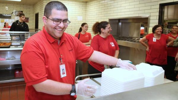 Justin Morales of New City works in the cafeteria at North Rockland High School in Theills June 11, 2014. ARC of Rockland placed him in the job.