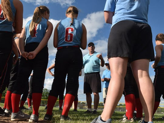 Southern Door softball coach Pat Delcore talks to the