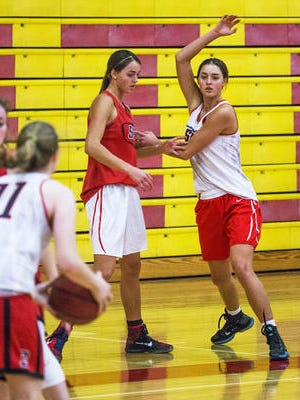 LeeAnne Wirth (right) and her twin sister Jenn will face top competition beginning Monday in the Nike TOC