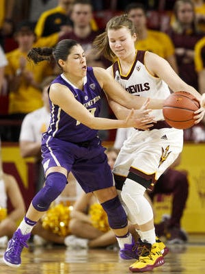Arizona State freshman Sydney Goodson, right, has improved her defense enough to earn more playing time. She is pictured working against Washington's national scoring leader Kelsey Plum. ASU plays at the Washington schools this week.