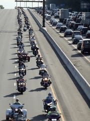 More than 2,000 motorcyclists take the 30-mile ride from Rockaway Township to Newark Wednesday for the 29th annual Gooch's Garlic Run to raise money for local children with physical and catastrophic illnesses. June 15, 2016, Rockaway, NJ