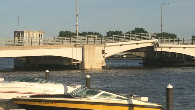 The Main Street bridge in Oshkosh remained closed as of 7:30 p.m. Friday, June 12, 2015, as a Winnebago County crew repaired the drawbridge.