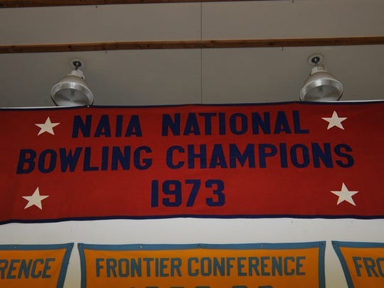 This banner, designating the CGF Argos as 1973 NAIA Bowling Champions, hangs from the rafters at UGF's McLaughlin Center.