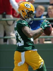 Packers cornerback Jaire Alexander intercepted Aaron Rodgers last week during OTAs.