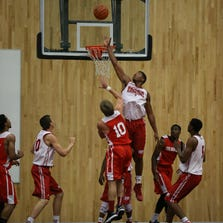 Devin Davis (center, in air) rises to alter a shot during Indiana's game against Laval last week in Montreal. The Hoosiers just completed a seven-day foreign tour of Canada.