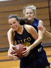 Ryelle Shuey, front, and Jalissa Nolt wrestle for a rebound during a recent Elco practice.