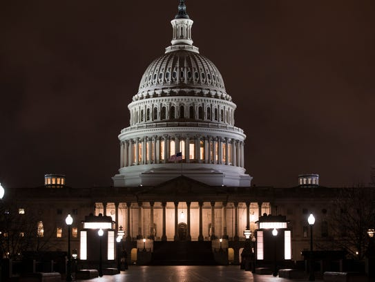 The U.S. Capitol is seen before dawn.