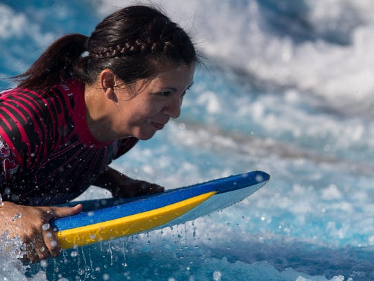 Valerie Delossantos learns to surf at Schlitterbahn