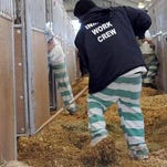 An inmate work crew supervised by the Hinds County Sheriffs Department clean barn 10 on the State Fairgrounds near downtown Jackson.