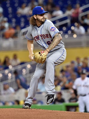 New York Mets starting pitcher Robert Gsellman throws in the first inning against the Miami Marlins at Marlins Park.