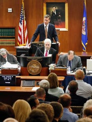 House Speaker Kurt Daudt, top center, leads the Minnesota