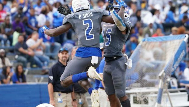 Wide receiver Patrick Smith (2) and quarterback Michael Hughes (15) celebrated after scoring a touchdown in Tennessee State's win Saturday over Virginia-Lynchburg.