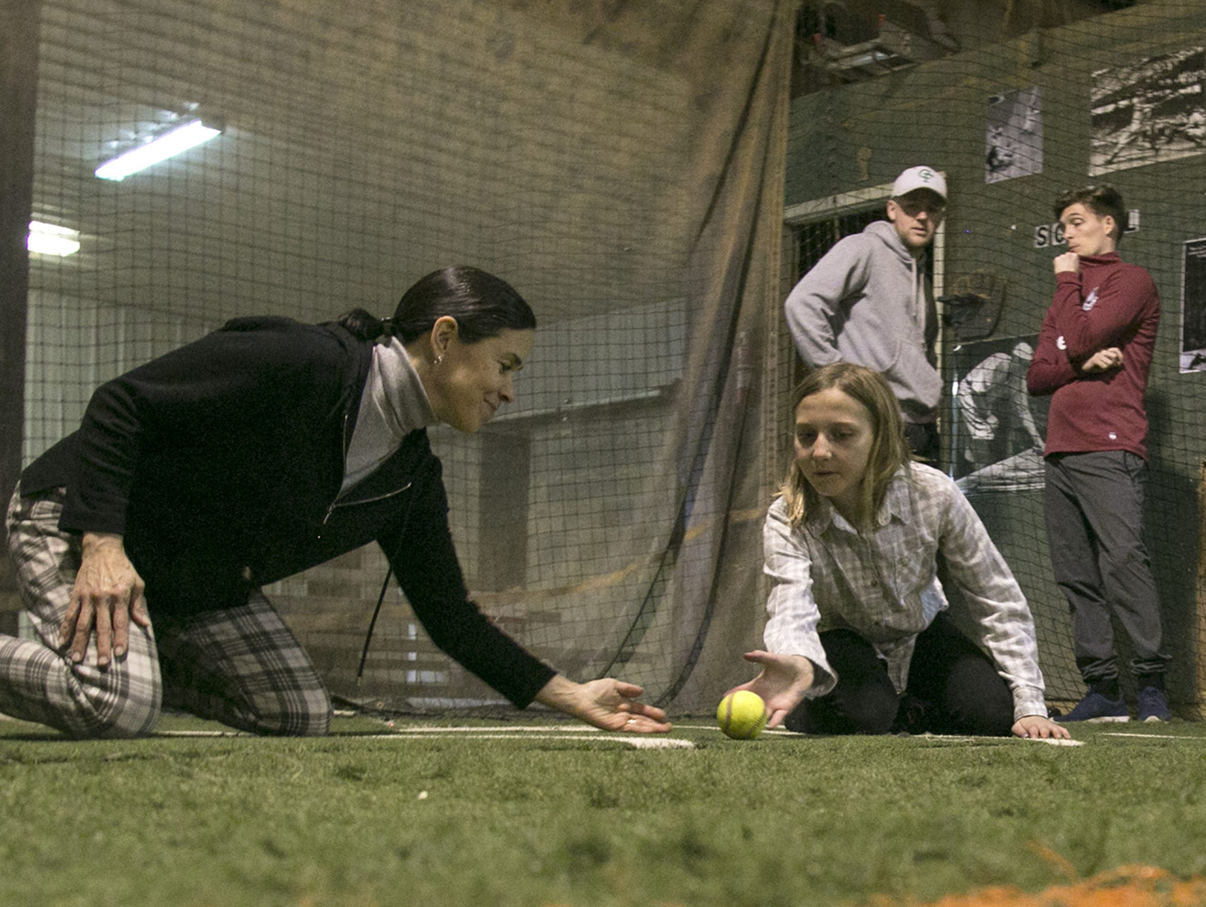 Jennifer Staab teaches a bit of baseball to her granddaughter