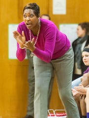 Mardela head coach Kesha Cook cheers for her team against